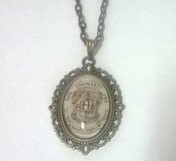 Медальон Harry Potter Hogwarts 4х3 см.